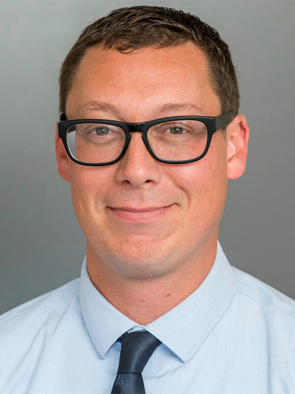 man with glasses wearing a tie