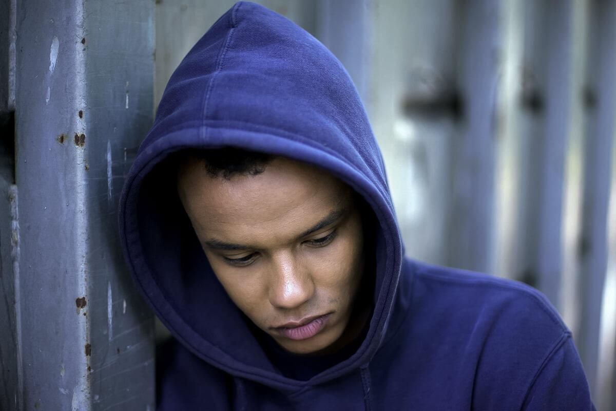 teen boy in a blue hoodie